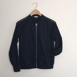 Gap Navy Bkue light Jacket with eyelet sleeves.
